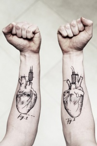 Awesome black ink hearts forearm tattoo by Lea Nahon