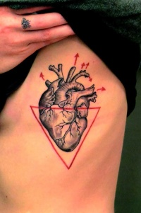Black heart and red triangle tattoo on ribs
