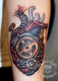 Coloured mechanical heart tattoo by Tim Kern