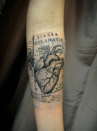 Cool heart tattoo on arm by Xoil